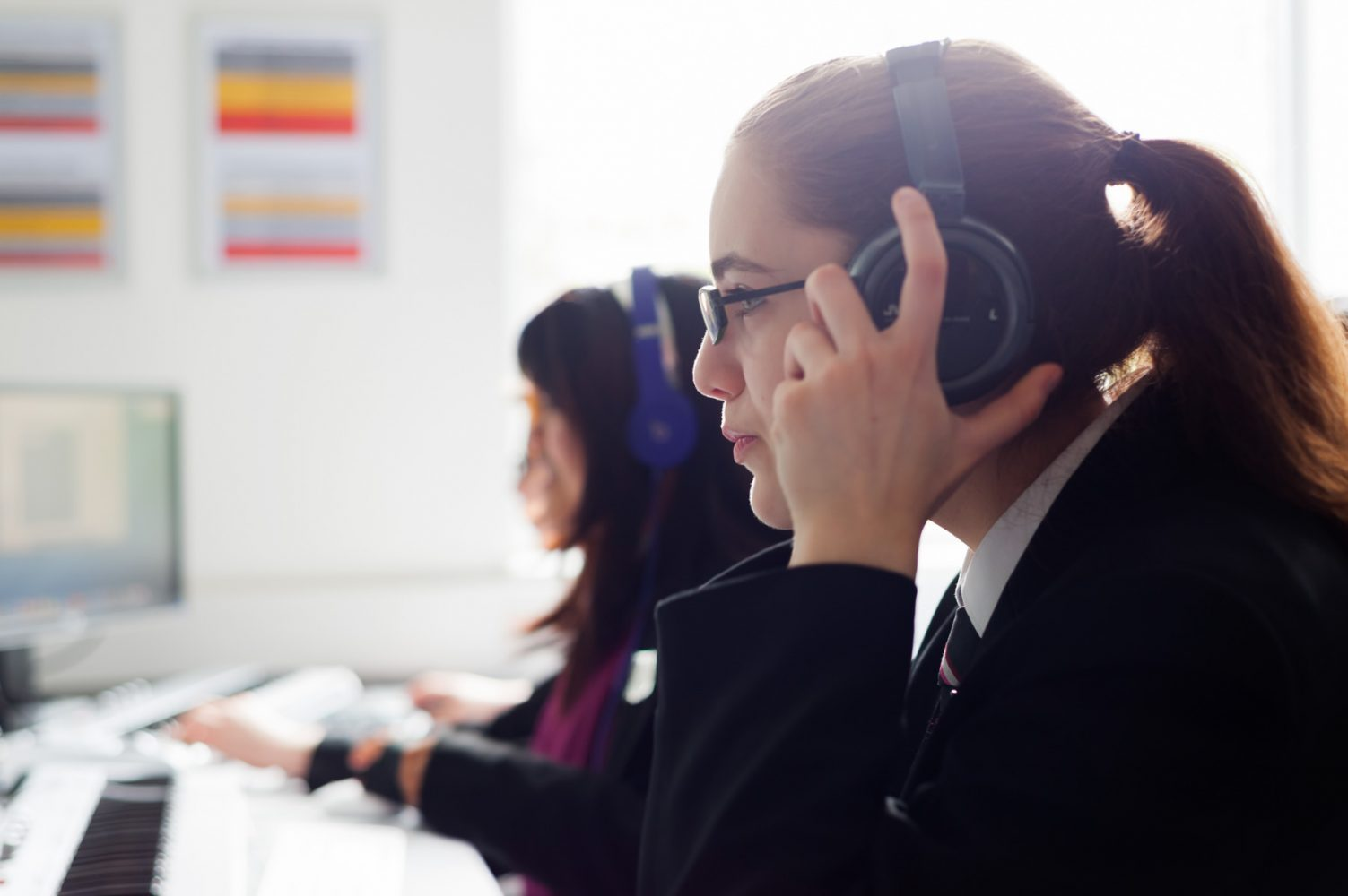Secondary school pupil wearing headphones
