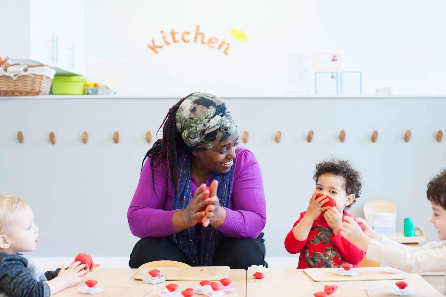 Image of nursery school children and smiling teacher