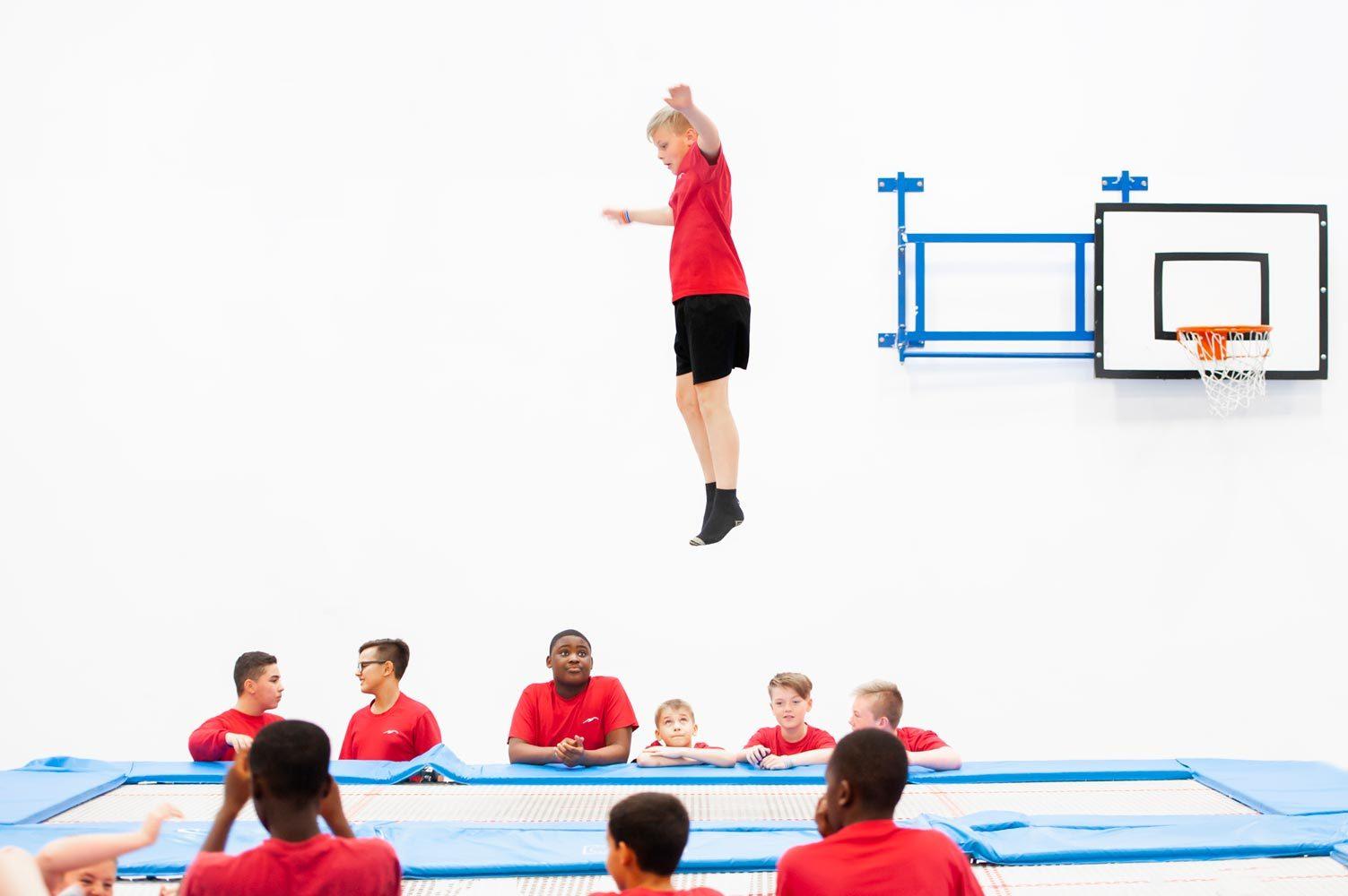 Photography of school children trampoling