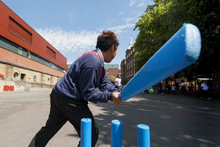 Photograph of pupils playing cricket in playground
