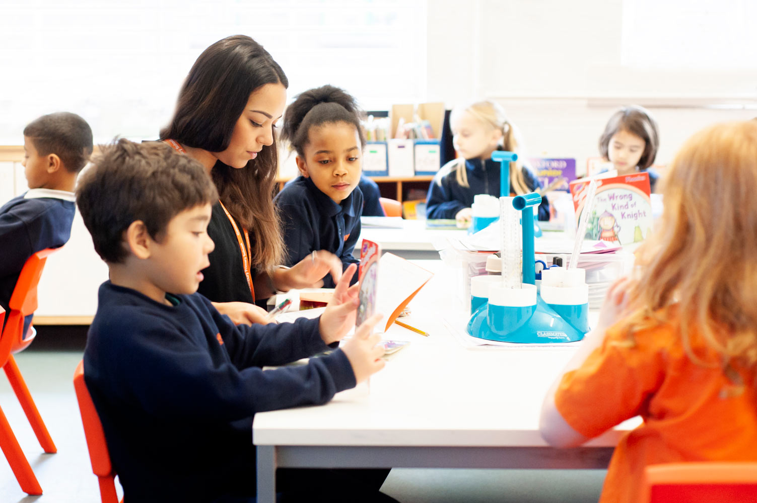 London school website photography of pupils interacting with teacher