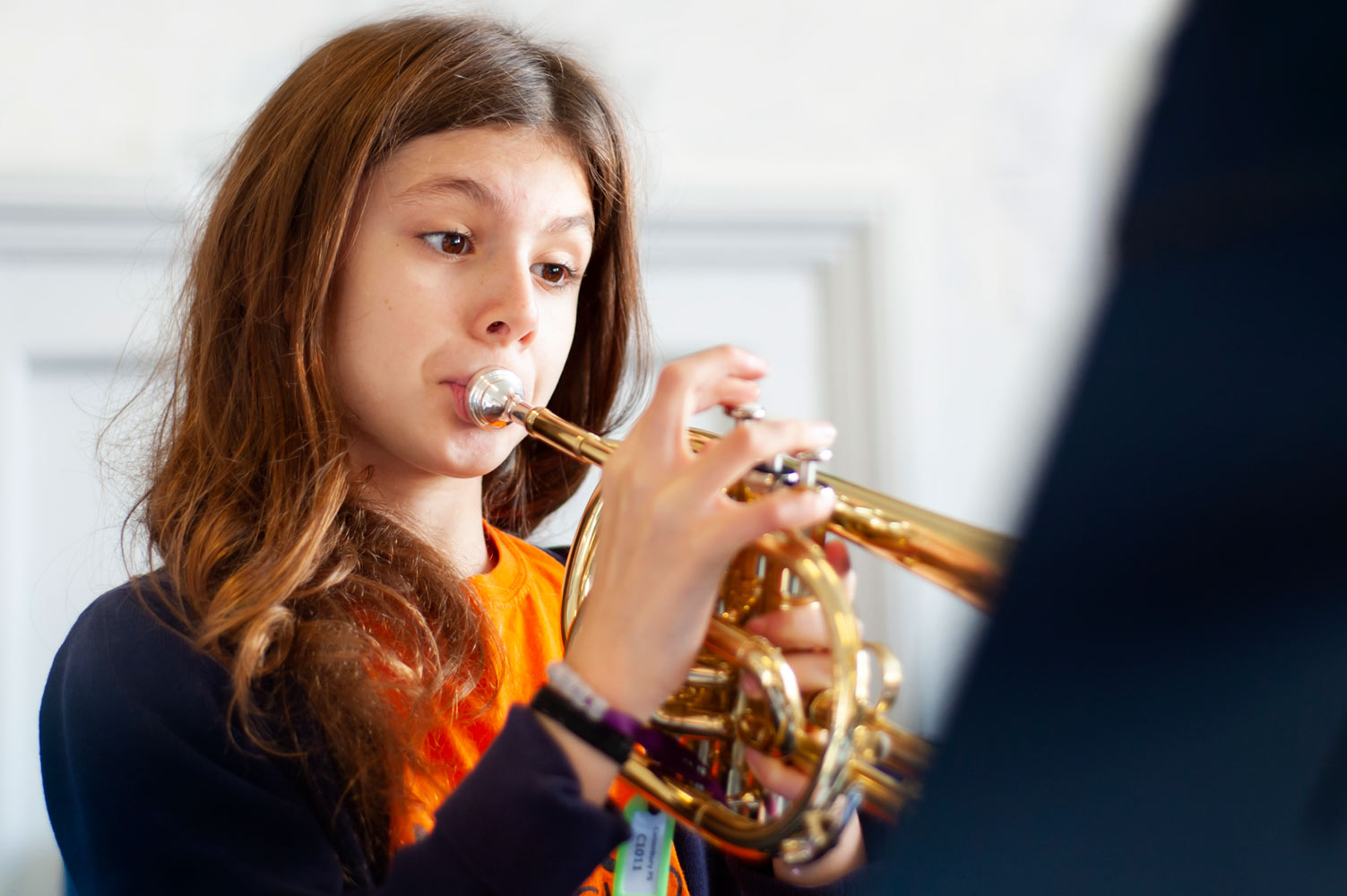 School pupil playing the trumpet