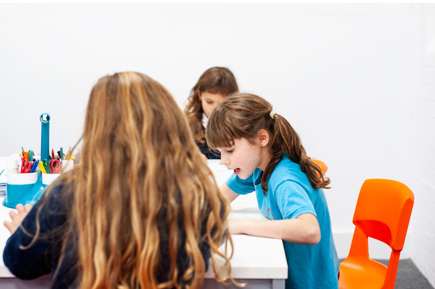 London school website photography of pupils working in classroom