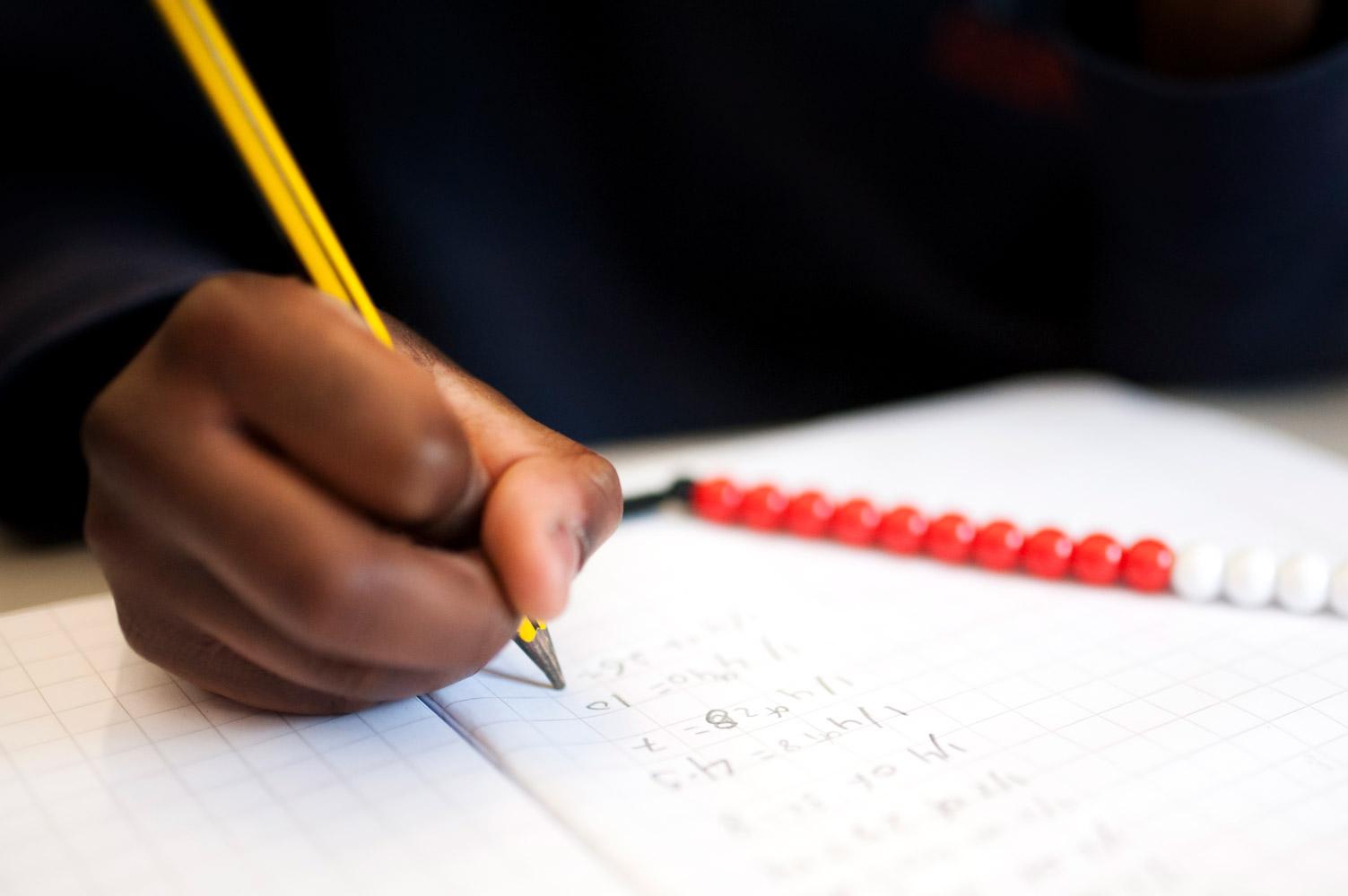 Close up of school pupil doing maths