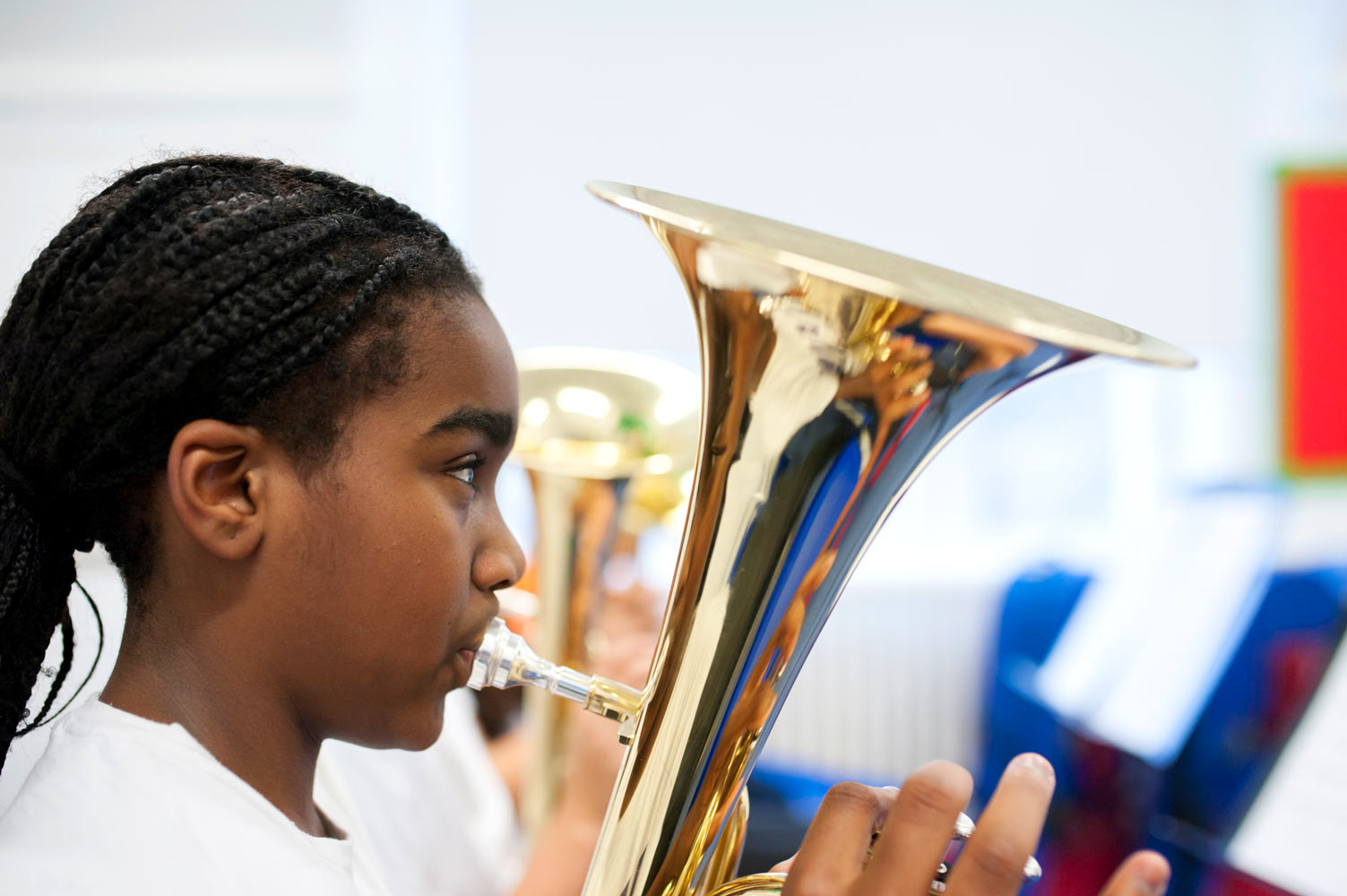 London school website photography of pupil playing trombone