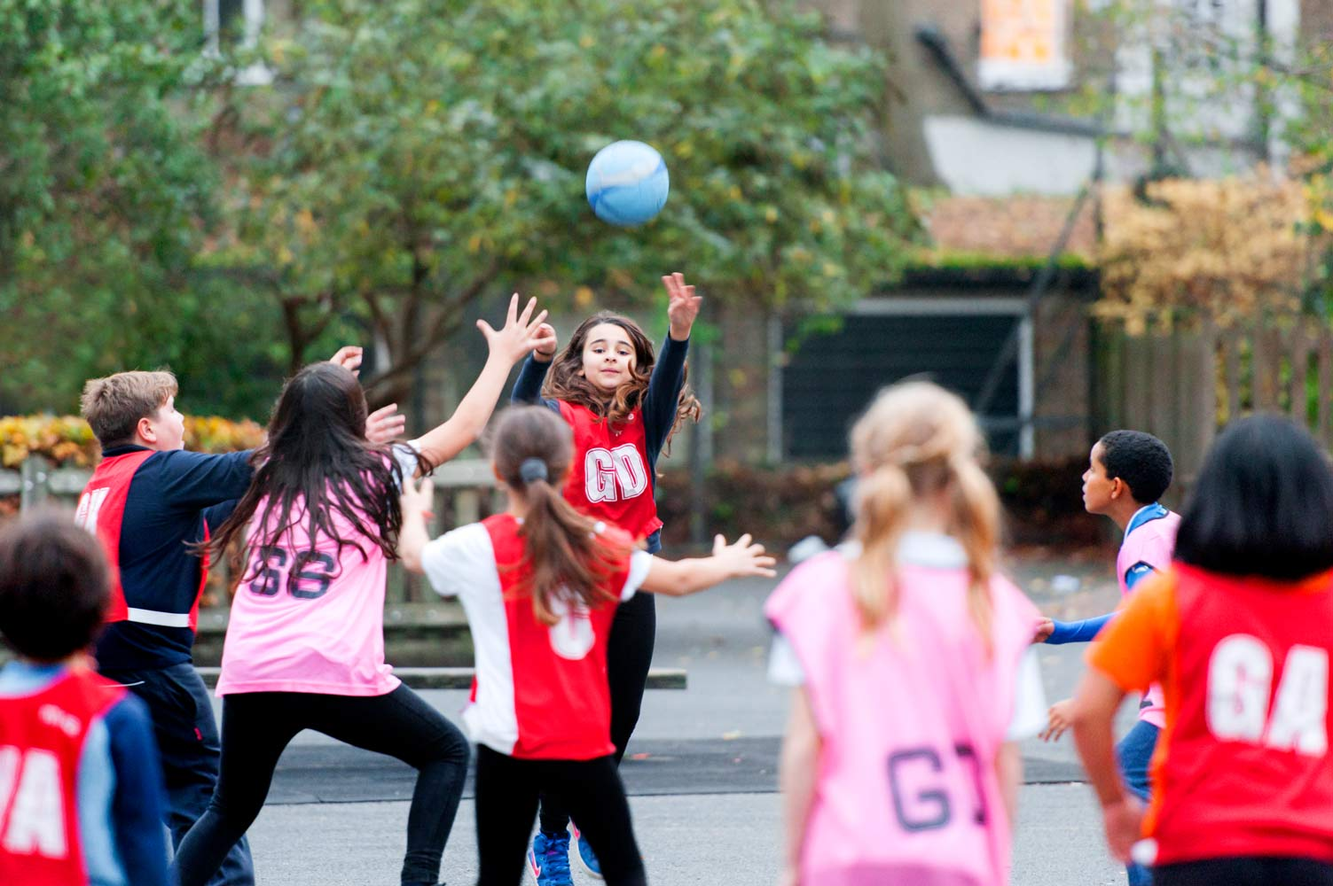 London school website photography of pupils playing netball