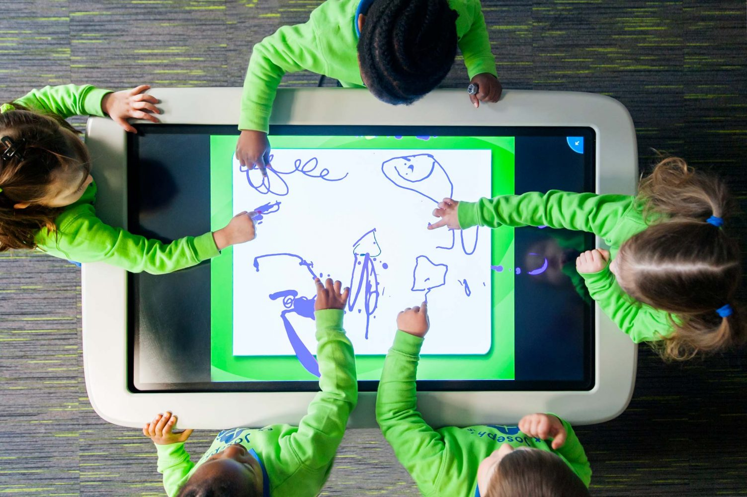 School pupils using large touch screen table