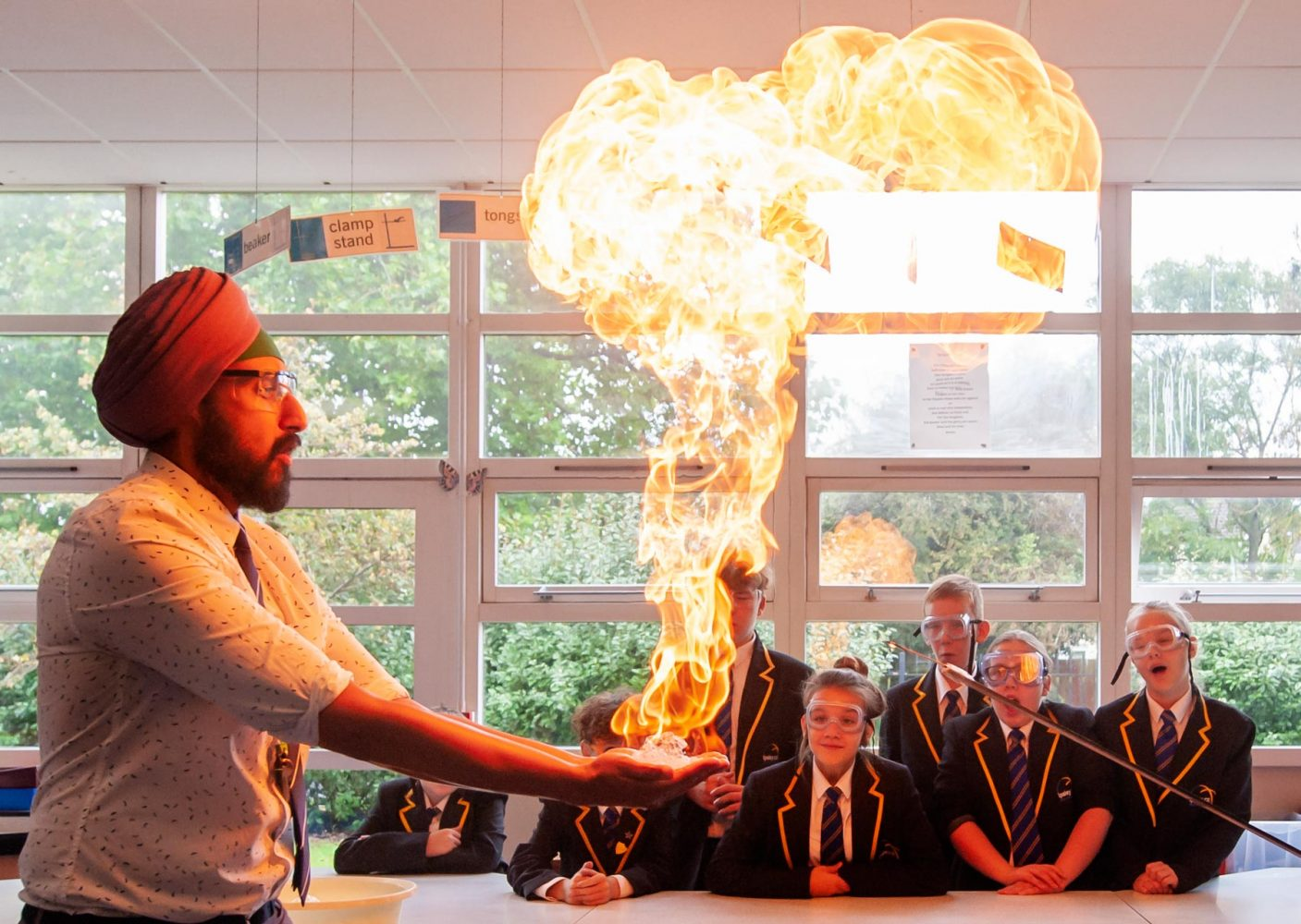School website photography of methane bubble demonstration in the classroom