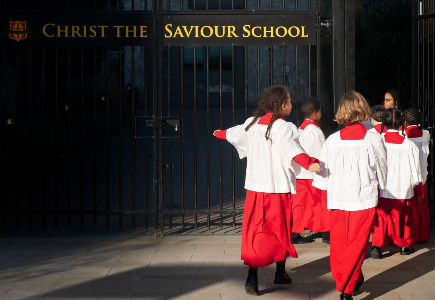 Primary school website photogrpahy of school choir returning through school gates