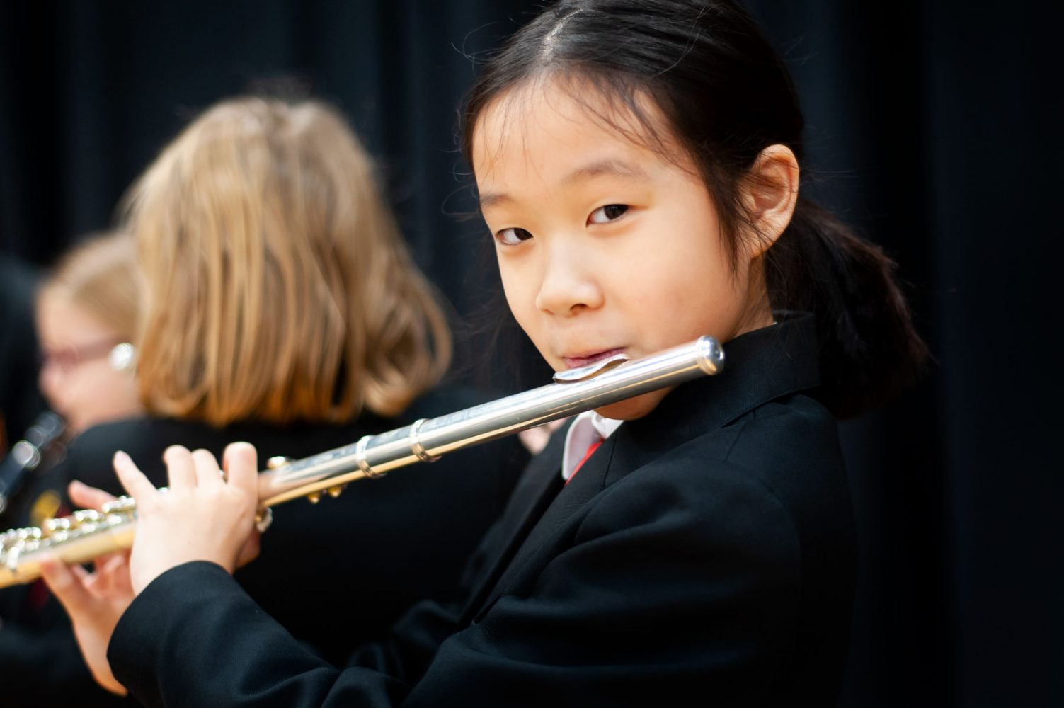 Primary school website photogrpahy of pupil playing flute